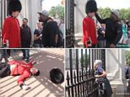trollstation prankster punches a 'queen's guard' outside buckingham palace