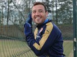 Arsenal star Santi Cazorla all smiles as he trains ahead of Arsenal's Premier League clash with Norwich