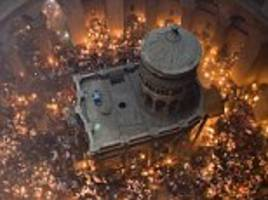 Burning passion: Jerusalem hosts ancient fire ceremony as Eastern Orthodox Christians celebrate the resurrection of Jesus