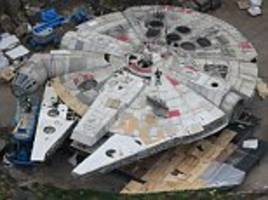 In a galaxy not so far away: Exclusive photographs reveal that the Millennium Falcon has touched down in England as Star Wars VIII is filmed at Pinewood Studios
