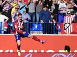 atletico madrid 1-0 rayo vallecano: sub antoine griezmann scores with first touch to keep diego simeone's men in title hunt