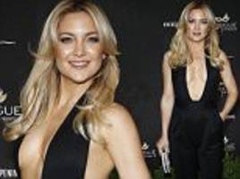 kate hudson flaunts her assets in plunging black jumpsuit as she leads the glamour at star-studded grand opening of a new las vegas nightclub