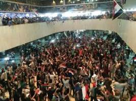 Iraq declares state of emergency as protestors storm into Parliament