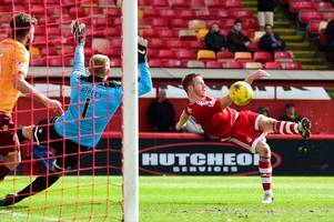 aberdeen hitman adam rooney aiming for quick return after limping off in motherwell win