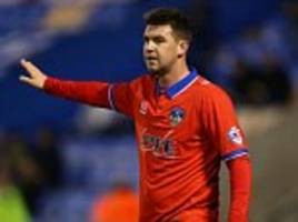 millwall subject to fa investigation as oldham's anthony gerrard claims he was hit by fan during pitch invasion