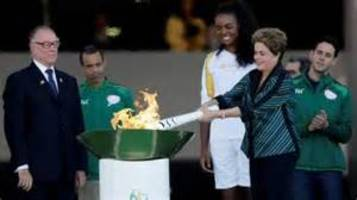 olympic flames arrives in brazil for torch relay ahead of rio games