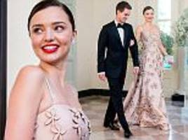 miranda kerr is the epitome of elegance in a dazzling blush coloured gown as she joins dapper beau evan spiegel at state dinner