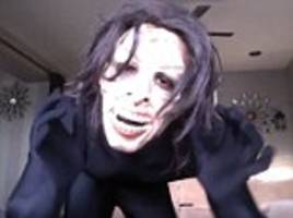 Terrifying moment man pranks his roomate by leaping out at her with a creepy mask - but luckily she sees the funny side