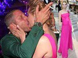 uma thurman is kissed to within an inch of her life as she puckers up to help raise money amfar's 23rd gala