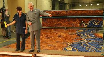 video: prince charles views the new carpet being made for buckingham palace