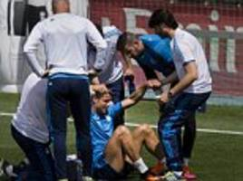 Real Madrid suffer Champions League final injury scare as Cristiano Ronaldo limps out of training following a heavy fall