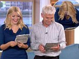 Holly Willoughby and Phillip Schofield laughing over viewer's photo frame misprint