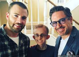 chris evans and robert downey jr. fly to california to surprise cancer-stricken fan