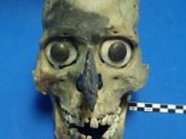 Mystery of the gruesome Aztec skull masks solved: Decorated remains found outside Mexican temple belong to slain warriors
