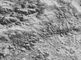 new horizons' highest resolution snaps of pluto are compiled into detailed image