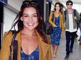 Louis Tomlinson's girlfriend Danielle Campbell stuns as they jet out of Heathrow