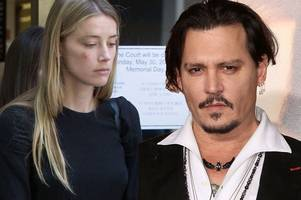 Amber Heard claims Johnny Depp slammed iPhone into her face as she seeks restraining order