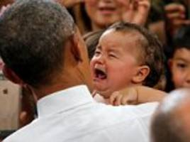 President Obama soothes crying baby during a stop while en route to visit Hiroshima