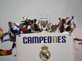 Real Madrid parade European Cup on open-top bus tour after returning home from Milan as thousands of jubilant fans celebrate Champions League victory over Atletico Madrid