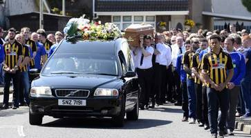 gerard quinn victim of evil act, priest tells mourners