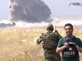 Brave TV reporter carries on broadcasting as ISIS suicide car bomb is destroyed metres away