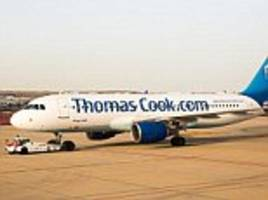 thomas cook passenger removed after she 'kept banging her head'