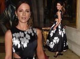 fashion royalty: kate beckinsale shows a hint of flesh in cutaway black and white dress as she leads the stars at the christian dior cruise show at blenheim palace