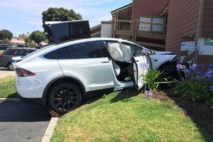 man drives tesla model x into building, blames everything but his foot
