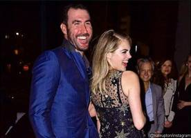 kate upton suffers wardrobe malfunction as her dress rips during her birthday party
