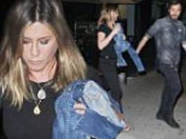 jennifer aniston covers up in all black as she heads to dinner with justin theroux in nyc... after denying pregnancy claims