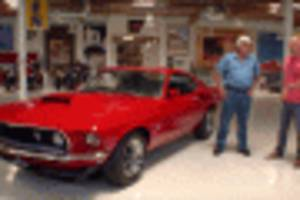 jay leno welcomes the boss 429 mustang to his garage