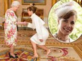 how low can you go? ballerina darcey almost ends up the floor as she curtseys to the smiling queen at buckingham palace
