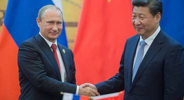 our views coincide - putin talks up russia's alliance with china