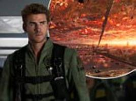 New Independence Day movie bombs with critics who mock star Liam Hemsworth for trying to be 'Tom Cruise in Top Gun' and lambaste the 'shockingly inept' and 'hilariously dumb' alien invasion plot