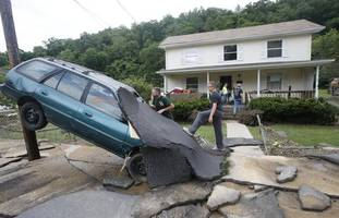at least 23 dead in west virginia flooding, governor says