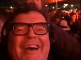 Labour's deputy leader Tom Watson parties into the night at Glastonbury as Jeremy Corbyn faces mass resignations after sacking Hilary Benn