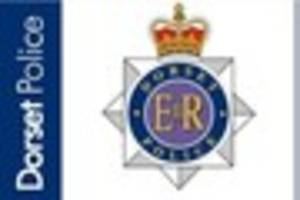 Armed officers in search after man stabbed in Kinson burglary