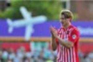 former exeter city defender christian ribeiro signs for oxford...