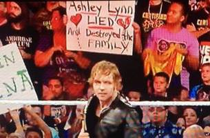 wwe fan brings extremely mysterious and personal sign to raw