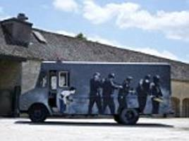 swat van painted by banksy is set to sell for £300,000 after it was revealed at an exclusive exhibition attended by brad pitt, angelina jolie, and cameron diaz