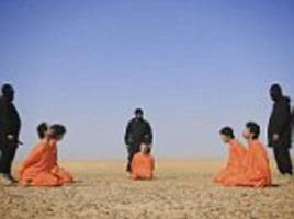 isis decapitate 5 'spies' and stick heads on spikes in latest execution video in syria