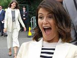 gemma arterton showcases her stylish spin on summer trends with a white trouser suit and nautical jumper as she braves the gloomy weather at wimbledon