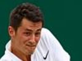 tomic's wimbledon match in balance