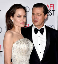 Brad Pitt and Angelina Jolie Divorce Rumors: Brad Pitt mingles with scantily-clad beauties amid divorce rumors