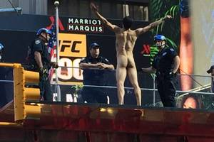 meanwhile on times square, naked man taunts cops; demands to speak with donald trump