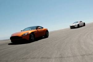 jay leno and the former stig race around in aston martins