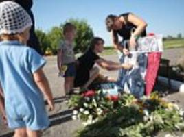 remembering mh17: ukrainian villagers hold vigil two years after malaysian airlines jet was show down killing all 298 on board