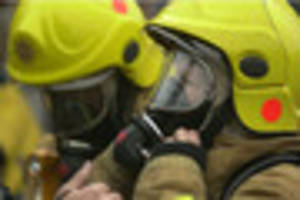 Woman taken to hospital after house fire