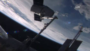 SpaceX Dragon capsule delivers new station docking port