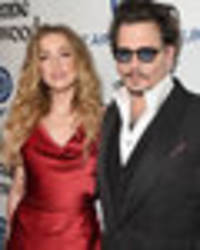 Amber Heard 'spending time' with billionaire Elon Musk as Johnny Depp divorce continues